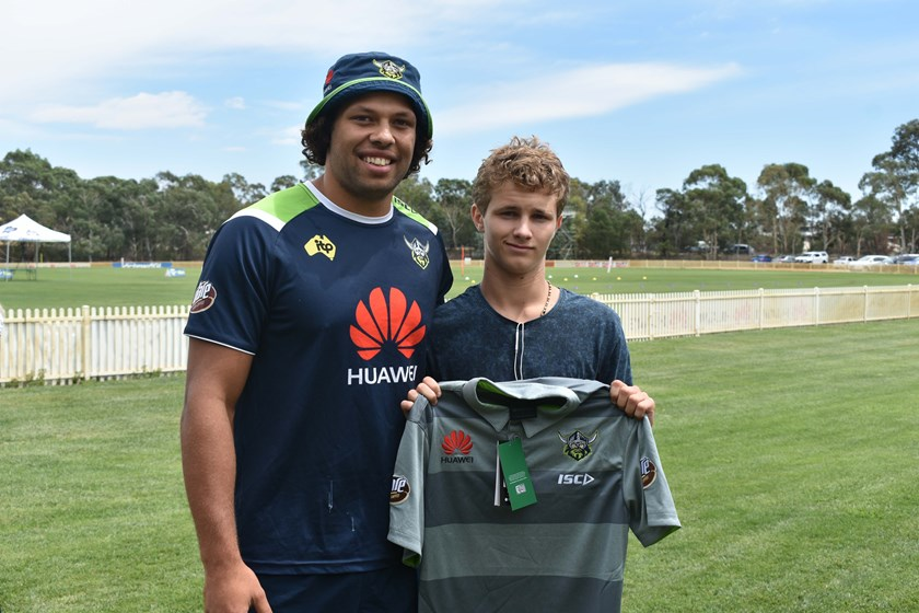 Sebastian Kris presents a Raiders Shirt for the upcoming Indigenous Youth Summit