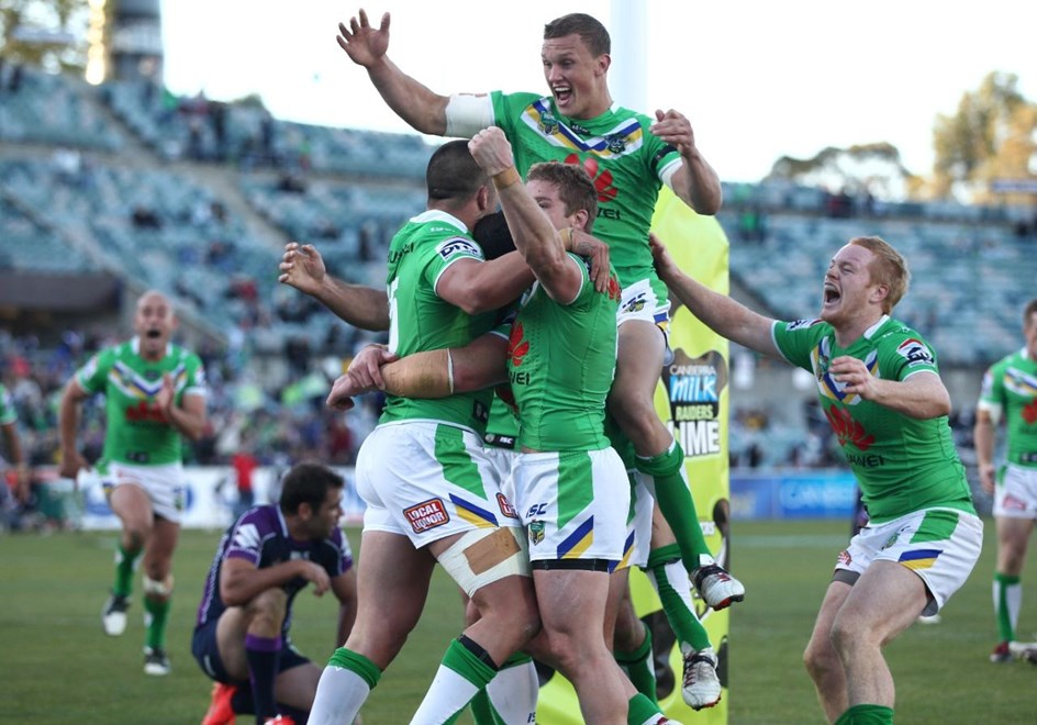 Photo by Colin Whelan copyright © nrlphotos.com :   The Raiders celebrate the winning try to Paul Vaughan    NRL Rugby League, Telstra Cup Round 7 Canberra Raiders v Melbourne Storm at Canberra, Sunday, April 20th  2014.