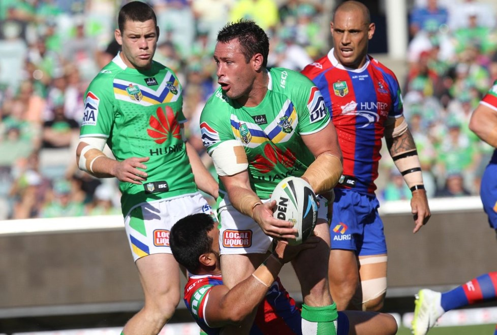 Photo by Colin Whelan copyright © nrlphotos.com :    Brett White looks to pass as he is held by Zane Tetivano    NRL Rugby League, Telstra Cup Round 6 Canberra Raiders v Newcastle Knights at Canberra, Saturday April 12th 2014.
