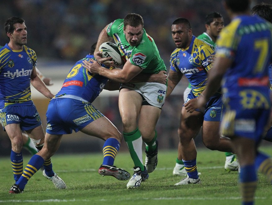 Photo by Colin Whelan copyright © nrlphotos.com :      Shannon Boyd grabbed by Tim Mannah                         NRL Rugby League, Round 22 Parramatta Eels v Canberra Raiders at TIO Stadium, Darwin, Saturday August 9th 2014