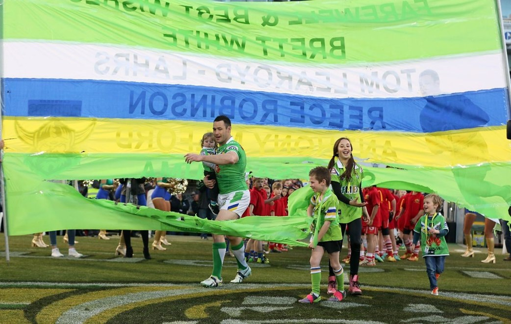 Digital Image by Robb Cox ©nrlphotos.com: Brett White and his children run onto the field and through a banner for his last match :NRL Rugby League - Round 26, Canberra Raiders V Parramatta Eels at GIO Stadium, Saturday September 6th 2014.