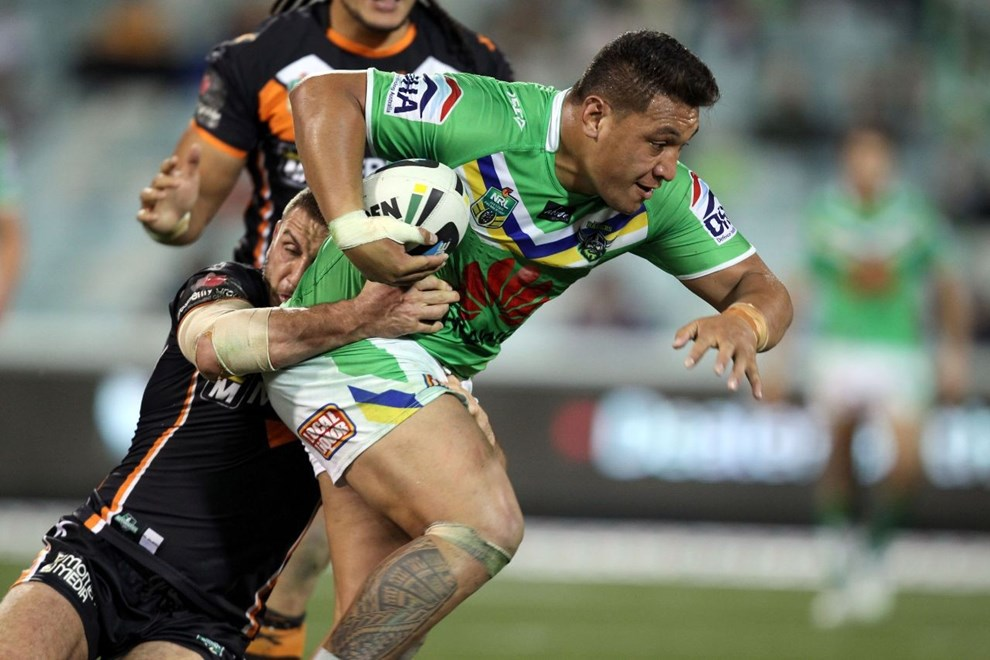 Photo by Jonathan Ng copyright nrlphotos.com : Josh Papalii hitting the ball up during NRL Rugby League, Round 25 Canberra Raiders v Wests Tigers at GIO Stadium, Saturday 30th of August 2014.