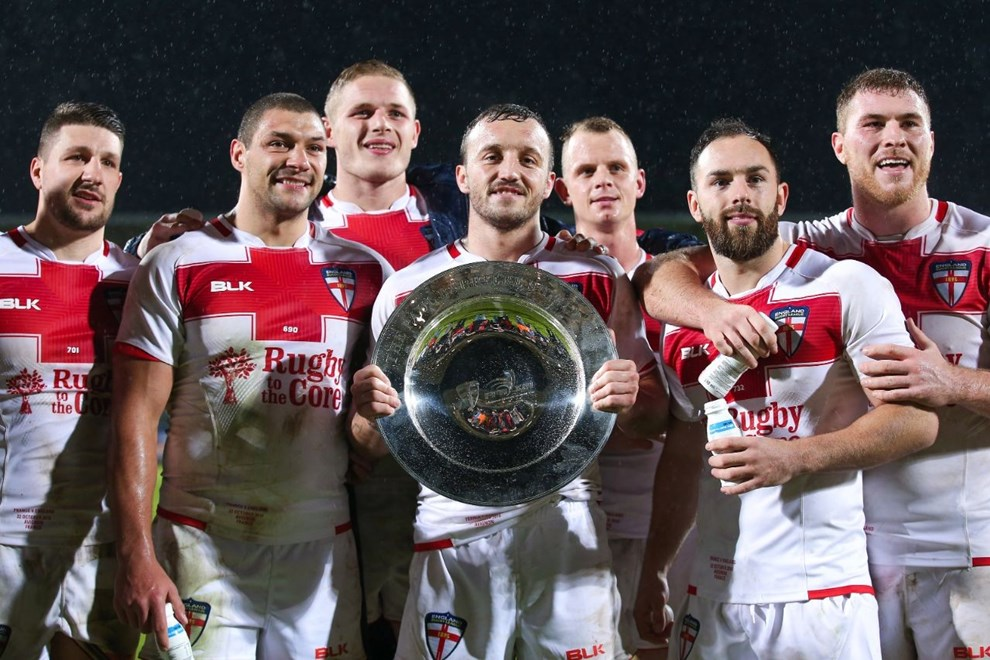 Picture by Alex Whitehead/SWpix.com - 22/10/16 - Rugby League - International Test - France v England - Parc des Sports, Avignon, France - England's Josh Hodgson (centre) and team-mates pictured with the trophy after the game.