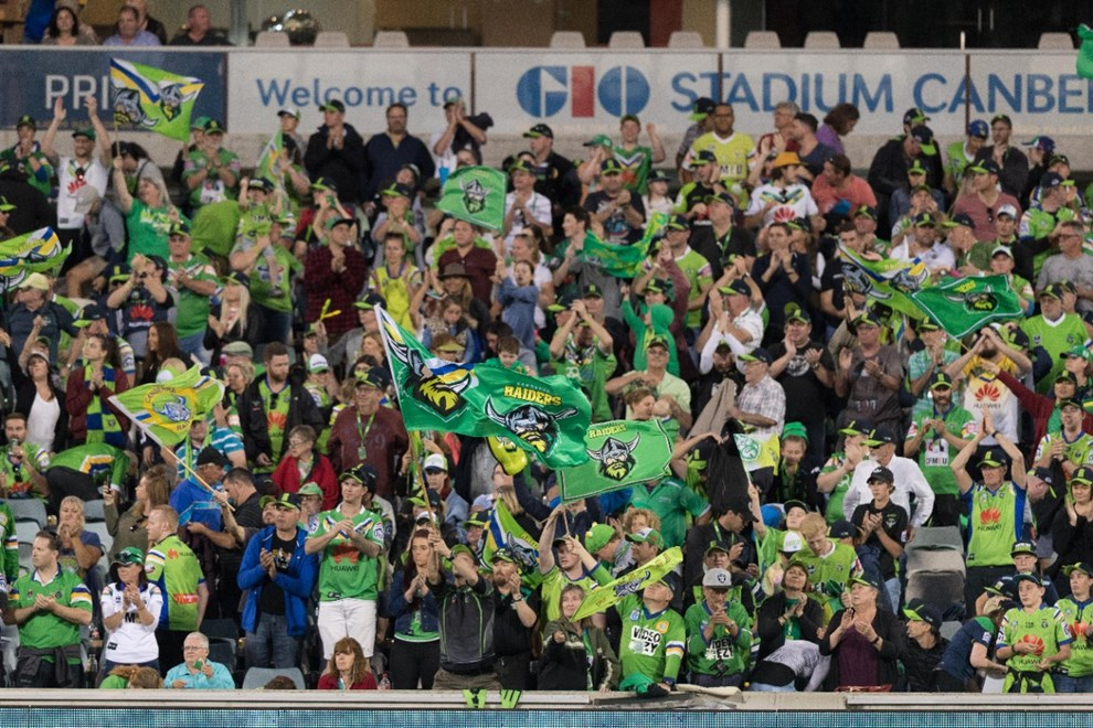 Fans cheer in the crowd - 1 APRIL 2017 - Australian National Rugby League (NRL) Round 5 - Canberra Raiders vs Parramatta Eels. Match was played on a Saturday evening at GIO Stadium