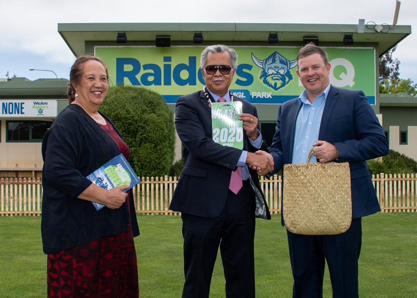 Mr & Mrs Puna exchanging gifts with Canberra Raiders Chief Operating Officer Jason Mathie